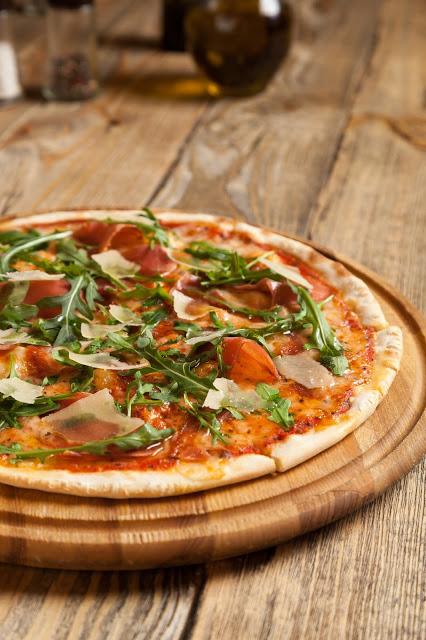 Pizza con crudo grana & ruocola